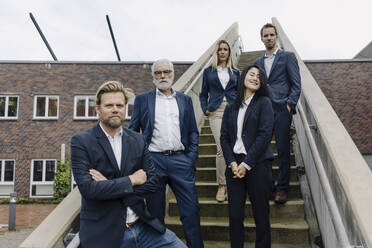 Portrait of confident business people on exterior stair - JOSF03944