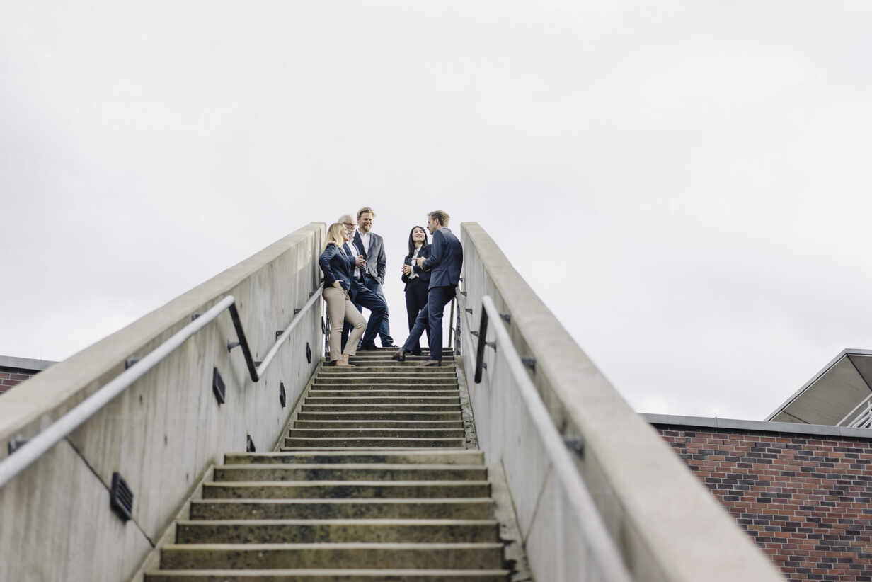Business people standing on exterior stair - JOSF03947 - Joseffson/Westend61