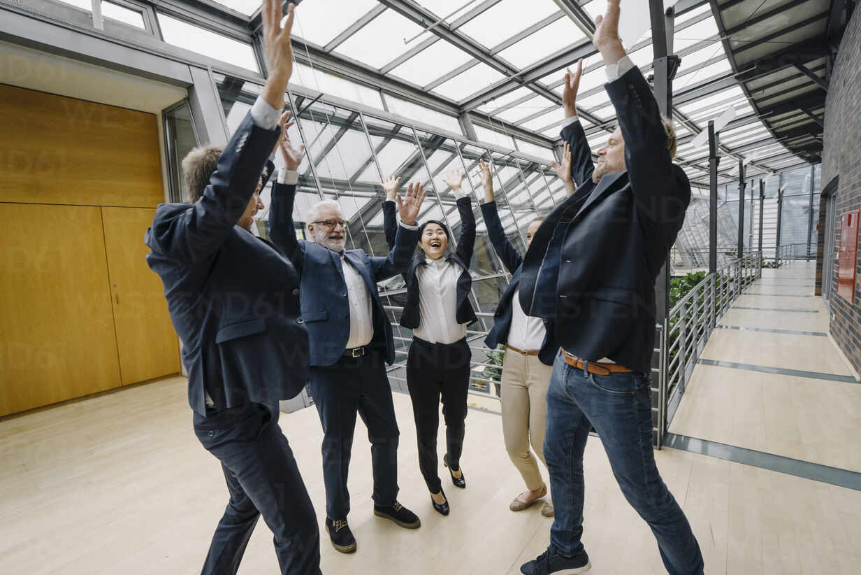 Happy business people cheering in modern office building - JOSF03956 - Joseffson/Westend61