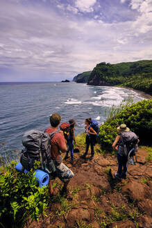 Backpackers hike through the Pololu Valley on the Big Island, Hawaii - CAVF70114