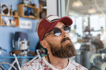 Matue man with red basecap and sunglasses - TCF06211