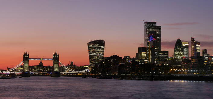 Panoramic view of Tower Bridge framing St. Paul's Cathedral with the City tower blocks at sunset, London, England, United Kingdom, Europe - RHPLF13217