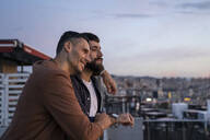 Gay couple on lookout above the city, Barcelona, Spain - AFVF04413