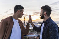 Gay couple on lookout above the city with view to the port, Barcelona, Spain - AFVF04431