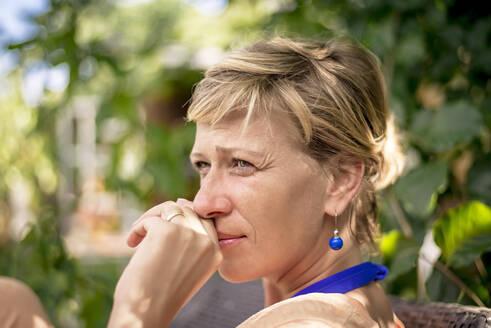 Portrait of woman in garden thinking - BFRF02155
