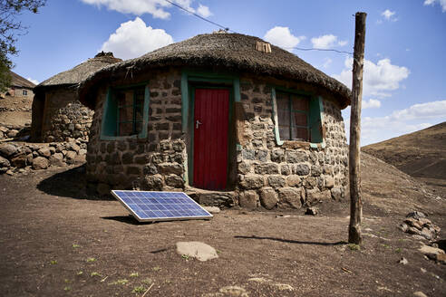 Traditional house with a solar panel, Lesotho - VEGF01174
