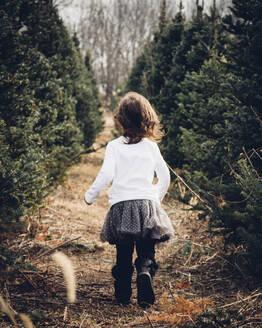 Girl running on field in forest - CAVF70851