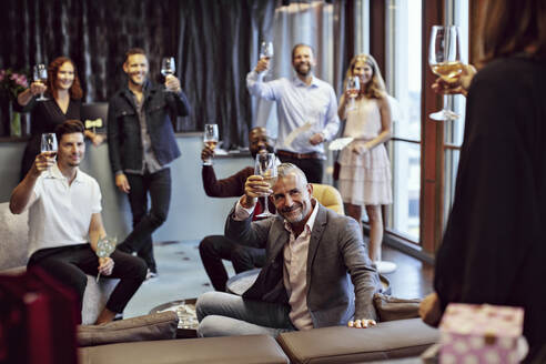 Business people raising wineglasses during conference - MASF15921
