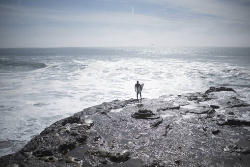 High angle view of man with surfboard at beach - CAVF71205