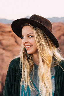 Portrait of a white smiling girl with a hat and blond hair - CAVF71368