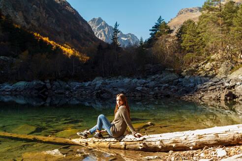 Nice Girl traveler on red autumn lake - CAVF71675