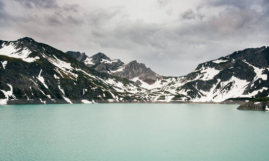 Snow covered mountainscape surrounding lake, Bludenz, Vorarlberg, Austria - ISF23379