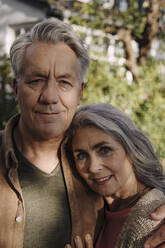 Portrait of senior couple in garden of their home - GUSF03133