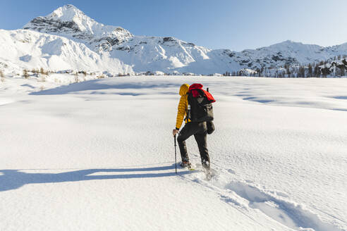Hiking with snowshoes in the mountains, Valmalenco, Sondrio, Italy - MCVF00131