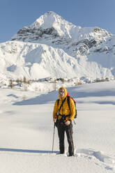 Hiking with snowshoes in the mountains, Valmalenco, Sondrio, Italy - MCVF00134