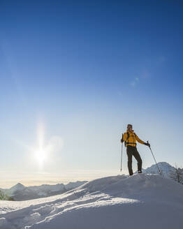 Hiking with snowshoes in the mountains, Valmalenco, Sondrio, Italy - MCVF00137