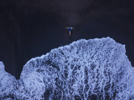 Aerial view of young woman with surfboard at the beach, Kedungu beach, Bali, Indonesia - KNTF03780