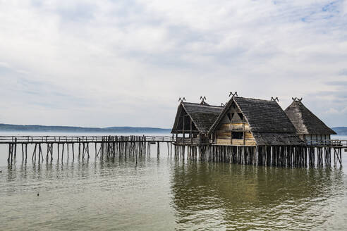 Germany, Unteruhldingen, Stilt houses on Lake Constance open-air archeological museum - RUNF03491