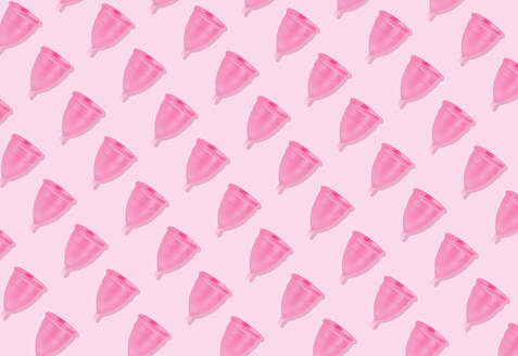 Eco-friendly and reusable pink menstrual cup pattern on pink background - GEMF03372