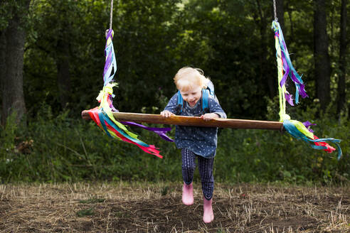 Little girl having fun with a swing - IHF00232