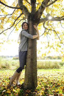 Woman tree hugging - ECPF00794