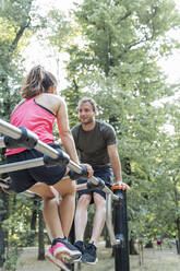 Man and woman exercising on a fitness trail - FBAF01103