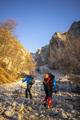 Two hikers beginning the ascent to the mountain, Orobie Alps, Lecco, Italy - MCVF00145