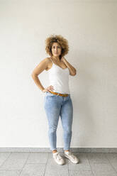 Mid adult woman wearing jeans - FMKF06058