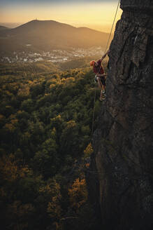 Man climbing at Battert rock at sunset, Baden-Baden, Germany - MSUF00123
