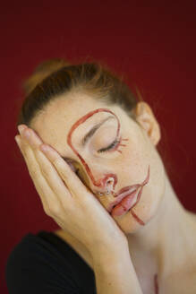 Portrait of young woman with paint on her face - AFVF04800