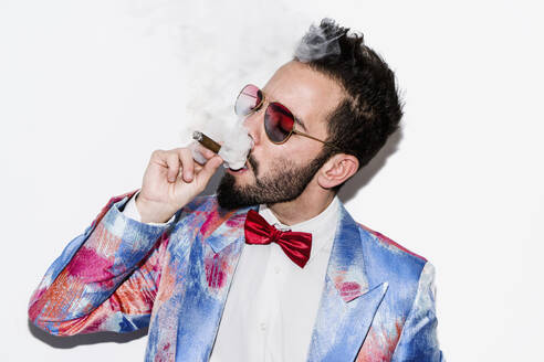 Cool and stylish man wearing a colorful suit and sunglasses and smoking a cigar - LOTF00083