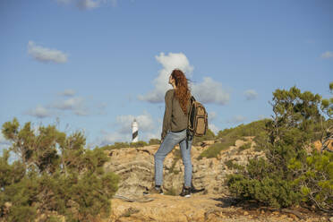 Redheaded young woman on a hiking trip, Ibiza, Spain - AFVF04847