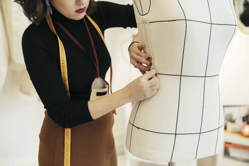 Crop view of fashion designer at work - MTBF00253