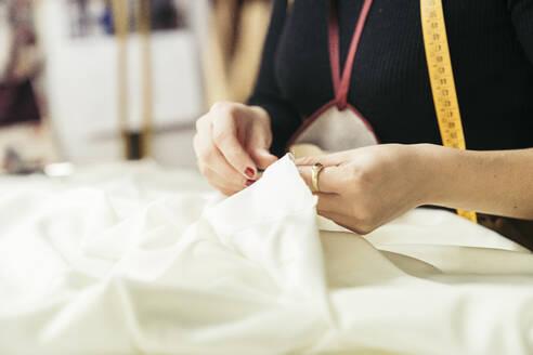 Fashion designer's hands at work - MTBF00265