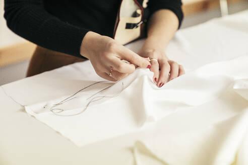 Fashion designer's hands at work - MTBF00268