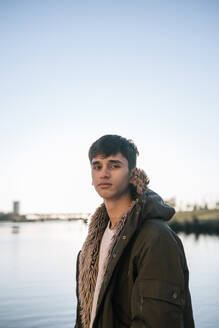 Portrait of teenage boy in front of a river - GRCF00010