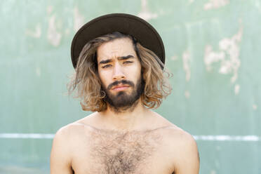 Portrait of shirtless young man wearing hat - AFVF04954
