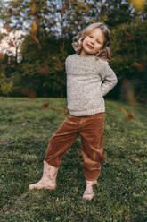 Portrait of smiling girl standing on a meadow in autumn - MFF05048