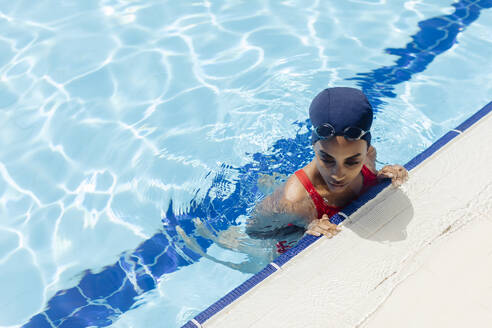 Young woman in swimming  pool seen from above - SODF00457