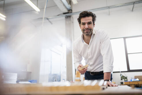 Portrait of a confident businessman in a factory - DIGF09053