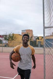 Teenager playing basketball - GRCF00076