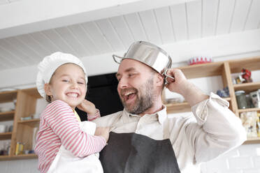 Father and daughter cooking in the kitchen - KMKF01163
