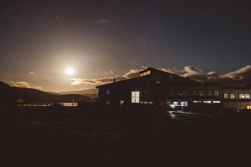 Modern building on seashore during sunset - CAVF72701