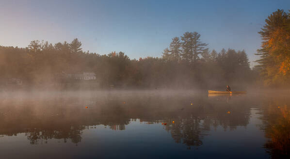 Solo paddling on a misty pond at sunrise. - CAVF72863