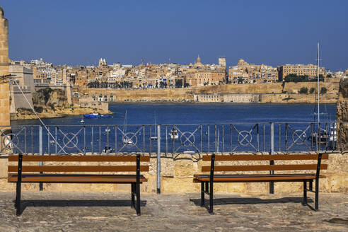 Malta, Valletta, City skyline and Grand Harbour from viewpoint with benches - ABOF00468