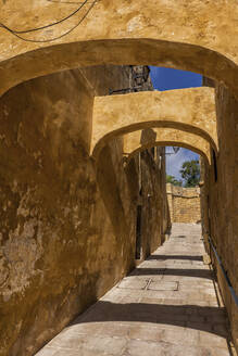 Malta, Gozo, Victoria, Narrow alley of historic Cittadella - ABOF00504