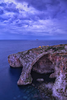 Malta, Blue Grotto natural arch at dusk - ABOF00507