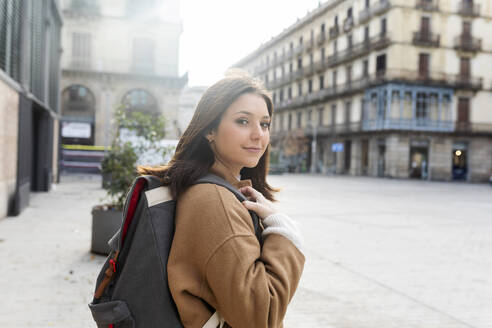 Portrait of young woman with backpack in the city, Barcelona, Spain - VABF02524