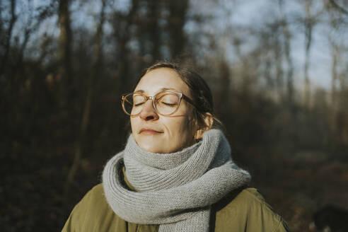 Portrait of woman during sunbath in winter - DWF00543