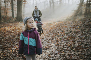 Mother with daughters during forest walk in autumn - DWF00549